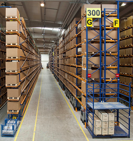 View of a warehouse with brown boxes on high shelving